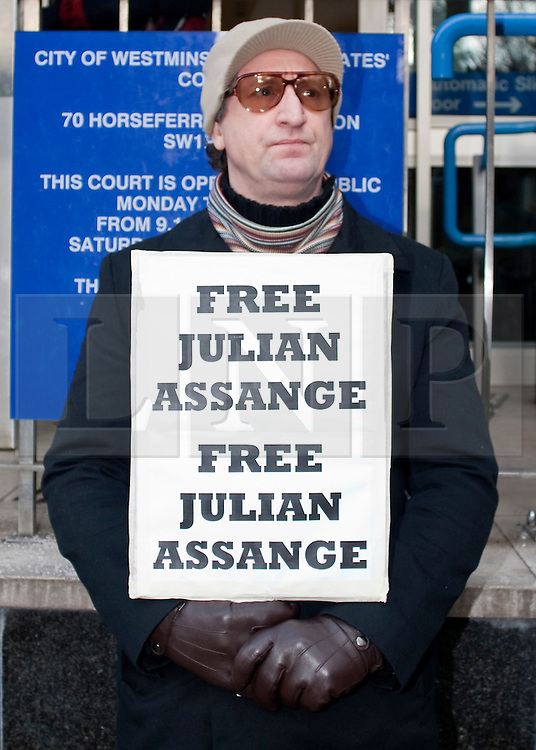 © under license to London News Pictures. 14.12.2010. A protestor outside Westminster Magistrates Court today (Tues). Julian Assange attends Court. Credit should read Matt Cetti-Roberts/London News Pictures