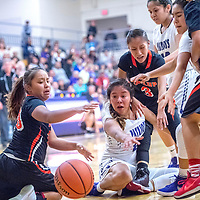 Gallup Bengal Kamryn Yazzie (20), left, and Miyamura Patriot Odessa Begaye (10), center, watch a ball bounce to the baseline ahead of Bengal  Amanda Mitchell (3) at Miyamura High School Thursday.