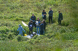 © Licensed to London News Pictures 27/09/2021.<br /> Biggin Hill, UK, Forensics and police officers at the scene. A large police cordon is in place around woodland and farmland in Biggin Hill, South East London. Unconfirmed local reports suggest a body has been discovered in a field. A police forensic tent has been in place overnight with forensic officers arriving on scene this morning. Photo credit:Grant Falvey/LNP