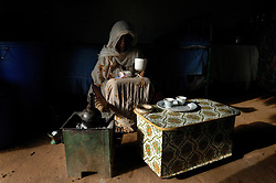 Tiblits brews coffee during a traditional coffee ceremony