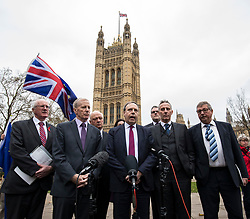 © Licensed to London News Pictures. 05/12/2017. London, UK. Nigel Dodds MP (centre), Deputy Leader of the DUP, speaks to the media in Victoria Gardens after Prime Minister Theresa May failed to secure a Brexit deal in Brussels on Monday 4 December 2017. Photo credit: Rob Pinney/LNP
