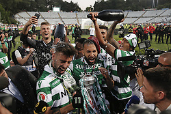 May 25, 2019 - Oeiras, Lisbon, Portugal - Bruno Fernandes of Sporting (L) and Jefferson of Sporting  (R)   celebrate  after winning the Portugal Cup Final football match between Sporting CP and FC Porto at Jamor stadium in Oeiras, outskirts of Lisbon, on May 25, 2019. (Credit Image: © Carlos Palma/NurPhoto via ZUMA Press)