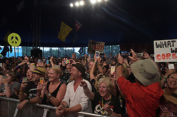 The crowd reacts as Labour leader Jeremy Corbyn arrives on the stage at LeftField at Glastonbury Festival, at Worthy Farm in Somerset.