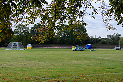 © Licensed to London News Pictures. 13/10/2021. London, UK. Police forensic tents and police car on Craneford Way Playing Fields following the fatal stabbing of a teenager. Police were called at 16:45BST on Tuesday, 12 October to reports of a stabbing in Craneford Way, Twickenham. Metropolitan Police Service (MPS) and London Ambulance Service (LAS) attended. They found an 18-year-old man who is believed to have sustained knife wounds. He was taken by LAS to an outer London hospital where he was pronounced dead at 17:54BST. Photo credit: Peter Manning/LNP
