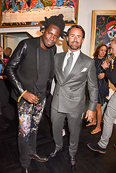 Left to right, Bradley Theodore and Jay Rutland at a private view of work by Bradley Theodore entitled 'The Second Coming' at the Maddox Gallery, 9 Maddox Street, London England. 19 April 2017.