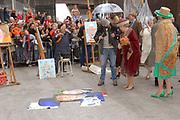 Her Majesty the queen and members of the royal family celebrate Saturday 29 April 2006 Queensday in the province flevoland in the cities  Zeewolde and almere.<br /> <br /> Hare Majesteit de Koningin en leden van de Koninklijke Familie vieren zaterdag 29 april 2006 Koninginnedag mee in de provincie Flevoland en wel in Zeewolde en Almere.<br /> <br /> On the Photo / Op dce foto: <br /> Queen Beatrix and major Jorritsma look with George Geutjes the portrait paints of CKV (centre artistic shaping) in almere / <br /> Koningin Beatrix en burgemeester Jorritsma bekijken samen met George Geutjes het portret schilderen van CKV (Centrum Kunstzinnige Vorming) in Almere.