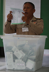 March 24, 2019 - Nonthaburi, Thailand - An election commission official seen displaying a ballot paper to the media while counting votes during Thailand's general election at a polling station in Nonthaburi province, on the outskirts of Bangkok, Thailand. (Credit Image: © Chaiwat Subprasom/SOPA Images via ZUMA Wire)