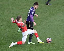Bristol City's Joe Bryan tackles West Ham's Carl Jenkinson - Photo mandatory by-line: Alex James/JMP - Mobile: 07966 386802 - 25/01/2015 - SPORT - Football - Bristol - Ashton Gate - Bristol City v West Ham United - FA Cup Fourth Round