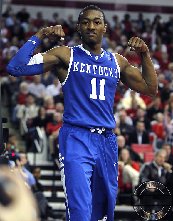 Kentucky s John Wall  flexed after getting the basket and the foul for some of his 24, as Kentucky defeated Georgia 80-68  on Wednesday March 3,  2010 in Athens, GA. Photo by Mark Cornelison     Staff.