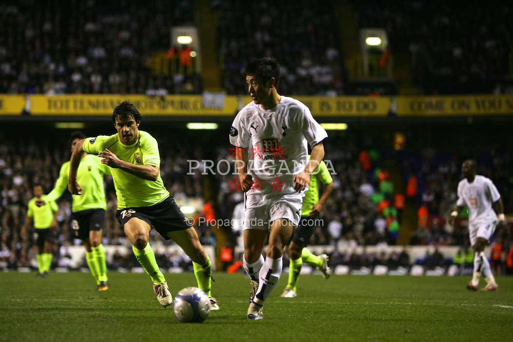 London, England - Wednesday, March 14, 2007: Tottenham Hotspur's Young-Pyo Lee and SC Braga's Andres Madrid during the UEFA Cup match at White Hart Lane. (Pic by Chris Ratcliffe/Propaganda)