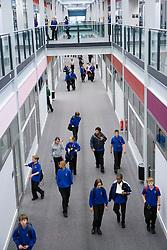 Students walking along the main corridor of new building of Djanogly City Academy ,
