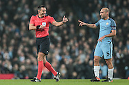 Bizarre moment as Slavko Vinčić (Referee) gets Pablo Zabaleta's (Manchester City) help to fix his radio and says thank you with a thumbs up during the Champions League match between Manchester City and Celtic at the Etihad Stadium, Manchester, England on 6 December 2016. Photo by Mark P Doherty.