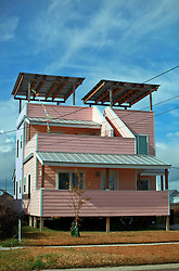 03 December 2013. Lower 9th Ward, New Orleans, Louisiana. <br /> The pink Frank Gehry designed 'Make it Right' home on Tennessee Street.<br /> Photo; Charlie Varley