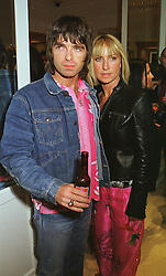 Musician NOEL GALLAGHER and his wife MEG MATHEWS, at a party in London on 23rd February 1999.MOO 126