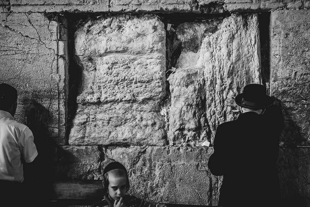Jerusalem - July 24, 2013: People pray at the Western Wall at 9:25pm.