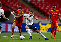 LONDON, ENGLAND - Thursday, October 8, 2020: Wales' Ben Woodburn (L) and England's Harry Winks during the International Friendly match between England and Wales at Wembley Stadium. The game was played behind closed doors due to the UK Government's social distancing laws prohibiting supporters from attending events inside stadiums as a result of the Coronavirus Pandemic. England won 3-0. (Pic by David Rawcliffe/Propaganda)
