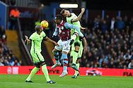 Jordan Ayew of Aston Villa © jumps for a header with Nicolas Otamendi of Manchester city (r). Barclays Premier league match, Aston Villa v Manchester city at Villa Park in Birmingham, Midlands  on Sunday 8th November 2015.<br /> pic by  Andrew Orchard, Andrew Orchard sports photography.