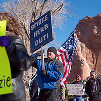 122314       Cable Hoover<br /> <br /> Shawn Gilbert carries a sign calling for Herb Yazzie's removal during a voting protest in Window Rock Tuesday.