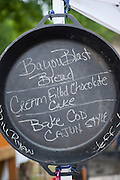 A menu is written in chalk in a dutch oven.
