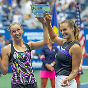 2019 US Open Tennis Tournament- Day Fourteen.  Elise Mertens of Belgium and Aryna Sabalenka of Belarus with the trophy after their victory against Victoria  Azarenka of Belarus and Ashleigh Barty of Australia in the Women's Doubles Final on Arthur Ashe Stadium during the 2019 US Open Tennis Tournament at the USTA Billie Jean King National Tennis Center on September 8th, 2019 in Flushing, Queens, New York City.  (Photo by Tim Clayton/Corbis via Getty Images)