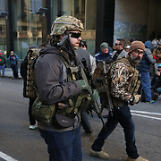 RICHMOND, VIRGINIA - JANUARY 20: Supporters of the 2nd Amendment open carry their weapons and hold flags during an organized protest near at the state capitol building in Richmond, VA on January 20, 2020. (Photo by Logan Cyrus)