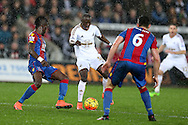 Modou Barrow of Swansea city © in action. Barclays Premier league match, Swansea city v Crystal Palace at the Liberty Stadium in Swansea, South Wales on Saturday 6th February 2016.<br /> pic by Andrew Orchard, Andrew Orchard sports photography.