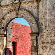 """Graceful archway entrance to Monasterio Santa Catalina in the """"White City"""" of Arequipa, Peru."""