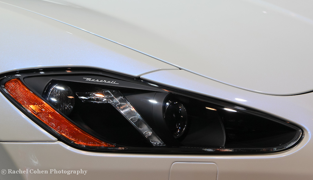"""""""Maserati Headlight""""<br /> <br /> The stylish and futuristic headlight detail and logo on a 2013 Maserati!!<br /> <br /> Cars and their Details by Rachel Cohen"""