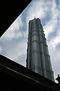 The Jinmao Tower, the country's tallest building at 420-meters, ranks as the world's third tallest. Its planners once considered adding a pagoda atop the building's roof to earn the title of world's tallest edifice. Those plans were later abandoned, but more high-rises were designed to satiate China's appetite for tall monuments of prosperity. In the eyes of many urban planners here, gleaming skyscrapers embody not only modernization, but also symbolize national pride. ..