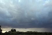 Heavy dark storm clouds lying low in sky