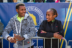 Elite runners meet and greet spectators at the finish line, defending champions Lelisa Desisa and Caroline Rotich