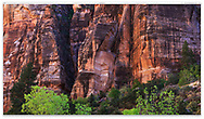 A series of imposing rock walls greet travelers upon exiting the long tunnel that leads into Zion Valley, Zion National Park, USA