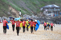 Beginners about to start their surfing lesson at Fistral, Newquay, Cornwall.