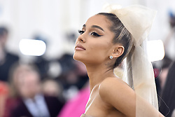 Ariana Grande walking the red carpet at The Metropolitan Museum of Art Costume Institute Benefit celebrating the opening of Heavenly Bodies : Fashion and the Catholic Imagination held at The Metropolitan Museum of Art  in New York, NY, on May 7, 2018. (Photo by Anthony Behar/Sipa USA)