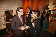Hamish Bowles and Alex Shulman, Alex Shulman of Vogue and Mulberry host a party for Giles Deacon. ( Mulberry for Giles) Mulberry. New Bond St. 20 September 2006. ONE TIME USE ONLY - DO NOT ARCHIVE  © Copyright Photograph by Dafydd Jones 66 Stockwell Park Rd. London SW9 0DA Tel 020 7733 0108 www.dafjones.com