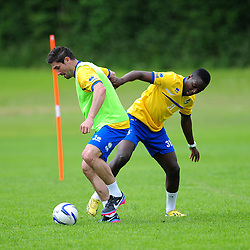 Bristol Rovers' Shaquille Hunter challenges Jim Paterson for the ball - Photo mandatory by-line: Dougie Allward/JMP - Tel: Mobile: 07966 386802 24/06/2013 - SPORT - FOOTBALL - Bristol -  Bristol Rovers - Pre Season Training - Npower League Two