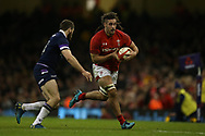 Josh Navidi of Wales tries to run past Tommy Seymour of Scotland. Wales v Scotland, NatWest 6 nations 2018 championship match at the Principality Stadium in Cardiff , South Wales on Saturday 3rd February 2018.<br /> pic by Andrew Orchard, Andrew Orchard sports photography