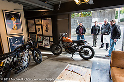 Harley-Davidson's (L>R) Dais Nagao, Ben McGinley, head of design Ray Drea and Charlie Wartgow check out the Deus Ex Machina new Tokyo store 3-days after its grand opening. Tokyo. Japan. Wednesday, December 10, 2014. Photograph ©2014 Michael Lichter.
