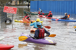 © Licensed to London News Pictures. 22/12/2019. Yalding, UK. Canoeists make their way along a flooded road near Yalding in Kent after the River Medway burst its banks. River levels remain high after a second night of heavy rain in the south. More rain is expected today. Photo credit: Peter Macdiarmid/LNP