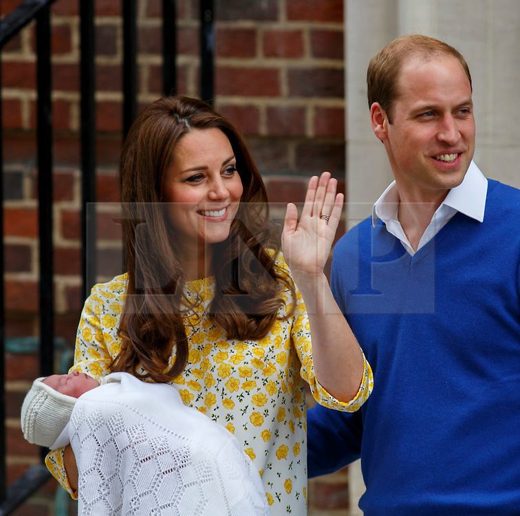 © Licensed to London News Pictures. 02/05/2015. LONDON, UK. Prince William, Duke of Cambridge and Catherine, Duchess of Cambridge posing to media outside The Lindo Wing with their newborn girl at St Mary's Hospital in London, England on May 2, 2015. The baby, as yet unnamed, is forth in line to the throne. Photo credit : Tolga Akmen/LNP