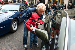 © Licensed to London News Pictures.02/11/2013. London, UK. People gather to admire cars at the Regent Street Motor Show that is the largest free motor show in the UK. More then 300 vehicles are displayed, from classic automobiles of the Victorian age right up to the very latest 'super' cars of today. Photo credit : Peter Kollanyi/LNP