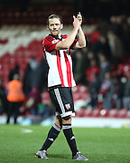 Brentford striker Lasse Vibe celebrating the win during the Sky Bet Championship match between Brentford and Huddersfield Town at Griffin Park, London, England on 19 December 2015. Photo by Matthew Redman.