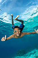 The kids of Tola Bali village, on the island of Pura in Indonesia's East Nusa Tenggara Province, enjoy swimming in the ocean with divers.  Due to the remoteness of the village, they often use goggles made at home, recycled from other materials.<br /> <br /> Shot in Indonesia