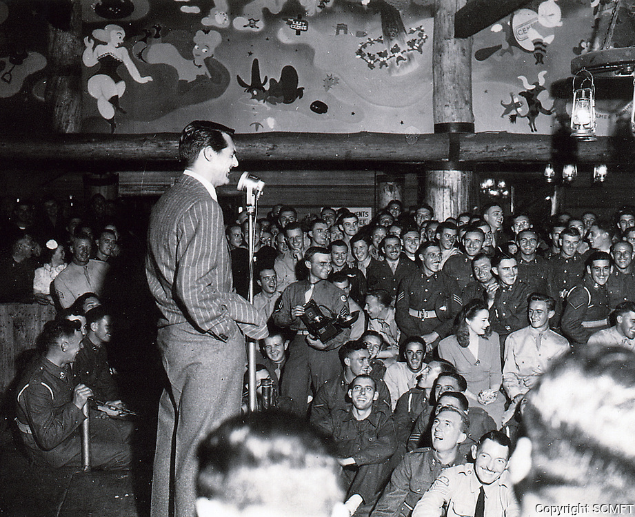 1944 Cary Grant entertains the servicemen at the Hollywood Canteen