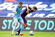 Derby County midfielder Graeme Shinnie  (4)  battles for possession during the EFL Sky Bet Championship match between Coventry City and Derby County at the Coventry Building Society Arena, Coventry, England on 23 October 2021.
