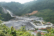Quarry for gravel to build roads into the rainforest. This was originally unspoilt primary rainforest. Marudi and Baram, Sarawak, Malaysia 2015<br /><br />These regions were part of the world's oldest rainforest, which dates back 160 million years. The indigenous native communities' survival depends on sustainable development of primary rainforest, a biodiversity resource, with countless insects, an array of birds and endangered species, which support one of the most diverse tropical ecosystems in the world. <br /><br />Borneo native peoples and their rainforest habitat revisited two decades later: 1989/1991 and 2012/2014/2015. <br /> <br /> Sarawak's primary rainforests have been systematically logged over decades, threatening the sustainable lifestyle of its indigenous peoples who relied on nomadic hunter-gathering and rotational slash & burn cultivation of small areas of forest to survive. Now only a few areas of pristine rainforest remain; for the Dayaks and Penan this spells disaster, a rapidly disappearing way of life, forced re-settlement, many becoming wage-slaves. Large and medium size tree trunks have been sawn down and dragged out by bulldozers, leaving destruction in their midst, and for the most part a primary rainforest ecosystem beyond repair. Nowadays palm oil plantations and hydro-electric dam projects cover hundreds of thousands of hectares of what was the world's oldest rainforest ecosystem which had some of the highest rates of flora and fauna endemism, species found there and nowhere else on Earth, and this deforestation has done irreparable ecological damage to that region