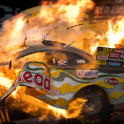 The NHRA funny car driven by Jim Head of Columbus, OH exploded during his semifinal run at the NHRA Summer Nationals at Heartland Park in Topeka, Kansas. Head walked away uninjured from the explosion.
