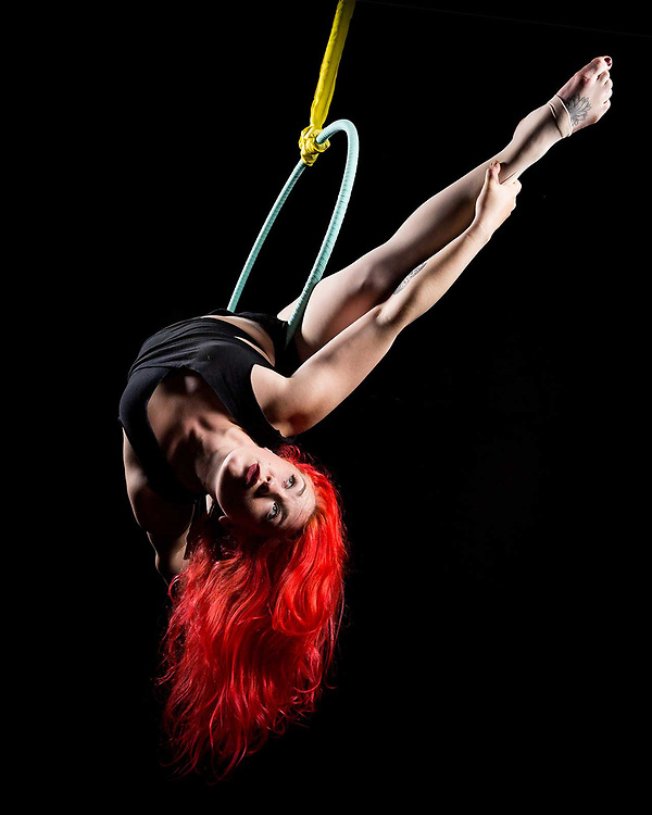 Aerial performer Sophia Godwin is photographed on the Lyra by lifestyle photographer Raymond Rudolph in a San Francisco studio