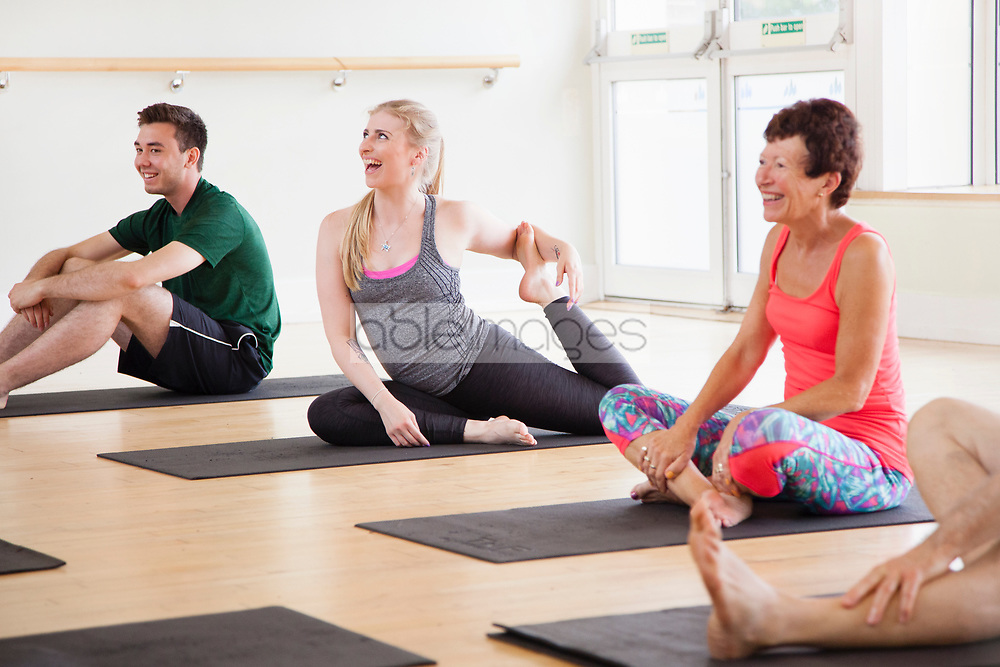 Group of People at Yoga Class Smiling