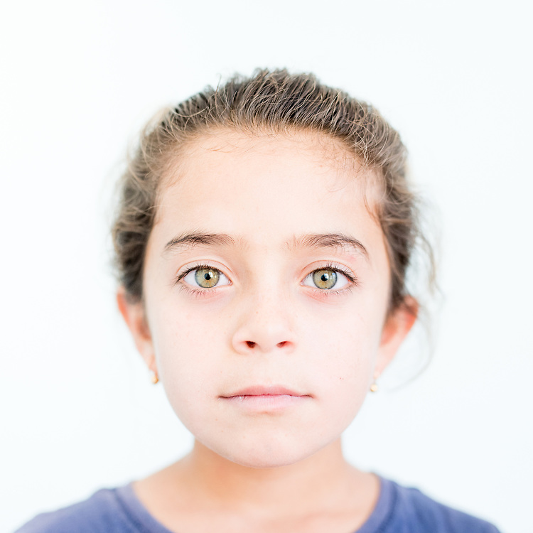 Madlan Dakhil Khalaf a 7 year old Yazidi from Shingal town, northern Iraq.<br /> <br /> This is a series of portraits of Yazidi refugees who were stranded since April 2016 in Greece.  All of them survived the Yazidi Genocide by ISIS in August 2014 and most of them have lost family members.